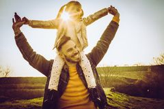 Father playing with his daughter in the park. royalty free stock photo