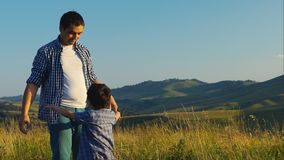 Father Playing With His Little Son In The Mountains stock footage