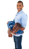 Father playing with his son. Against white background Stock Photography