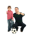 Father playing with his son. Happy father playing football with his son Royalty Free Stock Photography