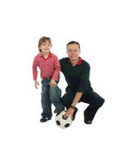 Father playing with his son. Happy father playing with his son football Royalty Free Stock Photography
