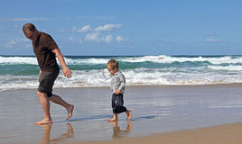 Father playing with his son. At the beach Royalty Free Stock Photos