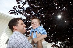 Father Playing With His Son Stock Images