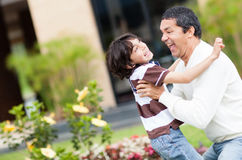 Father playing with his son Stock Photography