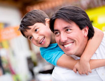 Father playing with his son Royalty Free Stock Photos