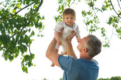 Father playing with his son. Royalty Free Stock Image