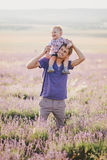 Father playing with his son in a lavender field Stock Photos