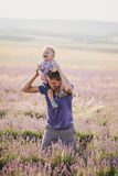 Father playing with his son in a lavender field Stock Photo