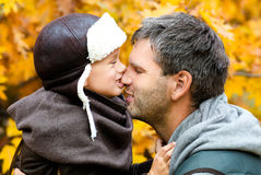 Father playing with his son in the park. At autumn day Royalty Free Stock Images