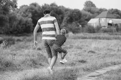 Father playing with his son Royalty Free Stock Images