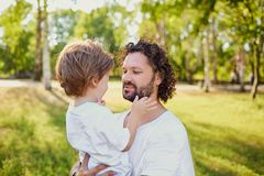 Father playing with his son in the park. Father`s Day Royalty Free Stock Photography