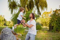 Father playing with his son in the park. Father`s Day Stock Photo