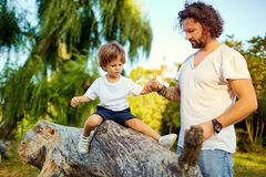 Father playing with his son in the park. Father`s Day Stock Image