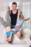 Father playing with his two sons. Stock Image