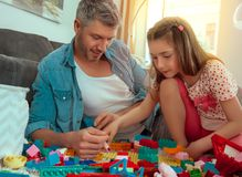 Playing dad with child. Father playing at home with toys royalty free stock photography