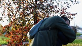 Father playing and holding son at urban city park. Happy dad an boy child hugging an autumn day outdoor together. Sunset. Father playing and hugging son at urban stock footage