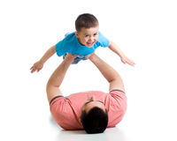 Father playing with kid boy Stock Image