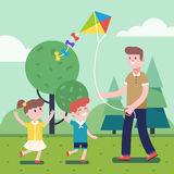Father playing with kids and flying kite outdoors Royalty Free Stock Photo