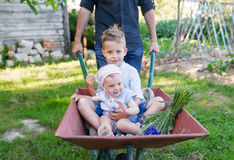 Father playing with kids using trolley in village royalty free stock photos
