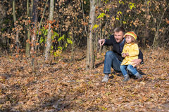 Father Playing with Little Baby Daughter in Autumnal Forest royalty free stock photos