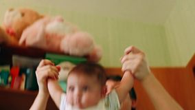Father playing with a newborn stock footage