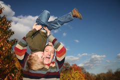 Father playing with son. Happy father playing with son upside down Royalty Free Stock Photos