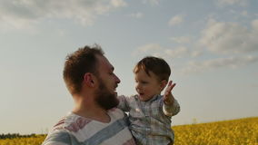 Father playing with son at field. slow motion stock footage