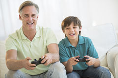 Father Playing Video Game Together At Home stock images