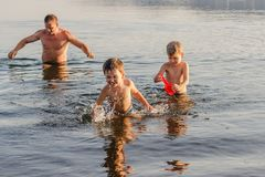 Free Father Playing With Two Children In The Lake In Summer, Happy Family On Summer Vacation Royalty Free Stock Photos - 120474008