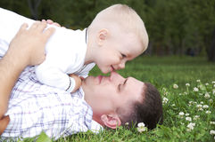 Father plays with the child. Father playing with baby, raised it high above them Stock Photos