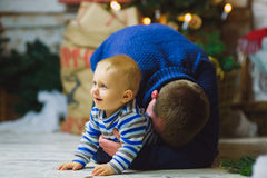 Father plays with the child In Home Holiday Living Stock Images