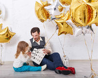 Father plays with daughter. Family celebration. Royalty Free Stock Photos