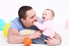 Father plays with the eight-monthly daughte Royalty Free Stock Photography