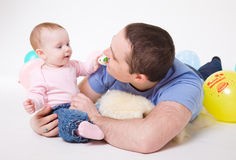 Father plays with the eight-monthly daughter Stock Photos