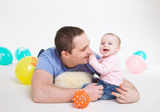 Father plays with the eight-monthly daughter Royalty Free Stock Photography