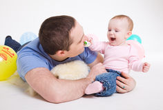 Father plays with the eight-monthly daughter Royalty Free Stock Photo
