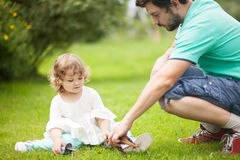 Father plays with his gaughter, plastic dinosaur fight Stock Photography