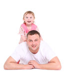 Father plays with the small daughter. Royalty Free Stock Photography
