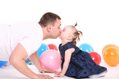 Father plays with the small daughter. Stock Images