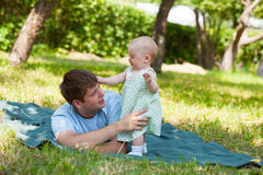 Father plays with the small daughter Royalty Free Stock Images