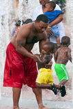 Father Plays With Son In Fountain At Atlanta Park royalty free stock photos