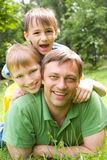 Father plays with young children royalty free stock image
