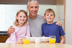 Free Father Posing With His Children In The Morning Royalty Free Stock Photography - 22371757