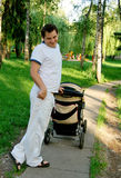 Father and pram Royalty Free Stock Photo