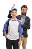 Father pranking his son with bunny ears Stock Photos
