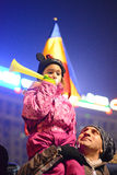 Father protesting with child against the government in Bucharest Stock Images