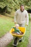 father pushing son wheelbarrow young στοκ εικόνες