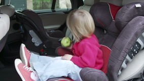 Father Putting Children Into Car Seats stock video footage