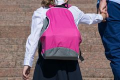 Father raises with his daughter on the stairs with a briefcase, to school royalty free stock photo