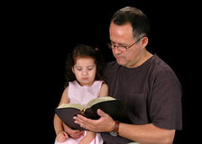 Father Reading Bible Stock Images